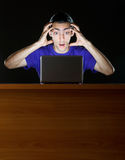 Hacker sitting in  room Stock Photography