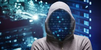 Composite image of hacker standing with arms crossed Royalty Free Stock Photo