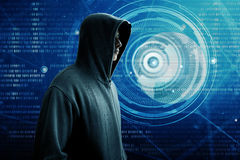 Hacker standing over a screen. With binary code Stock Image