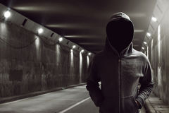 Hacker. Standing in the tunnel Stock Image