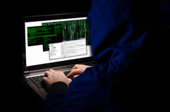 Hacker stealing data from computer Stock Images