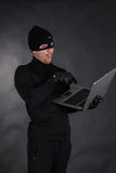 Hacker stealing data Stock Photo