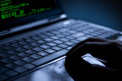 Hacker stealing data from a laptop royalty free stock photo