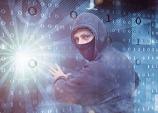 Hacker stealing data. Masked hacker stealing private data Stock Images