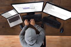 Hacker Stealing Information From Computers Stock Photo