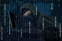 Hacker stealing laptop and breaking the security system Royalty Free Stock Image