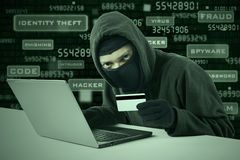 A hacker stealing online credit card Stock Images