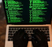 Hacker stealing password and identity, computer crime. Lots of digits on the computer screen. Top view stock images