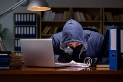 The hacker stealing personal data from home computer Stock Photography
