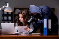 The hacker stealing personal data from home computer Royalty Free Stock Photos