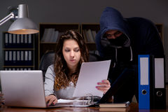 The hacker stealing personal data from home computer Stock Image
