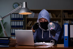 The hacker stealing personal data from home computer Royalty Free Stock Image