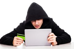 Hacker with a tablet Royalty Free Stock Photo