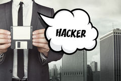 Hacker text on speech bubble with businessman Royalty Free Stock Images