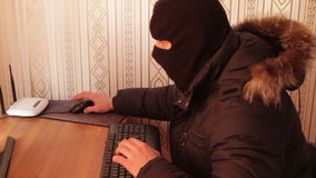 Hacker theft working with computer. Great video for and project involving cyber criminality and thief stock footage