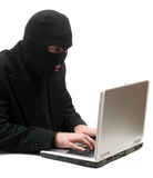 Hacker Typing. A business hacker is breaking into a laptop computer and stealing information, isolated against a white background Royalty Free Stock Photo
