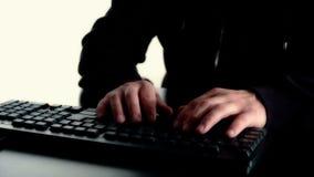 Hacker typing on black keyboard stock footage