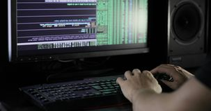 Hacker`s hands typing on computer. working with computer, hacking and writing. Hacker typing on keyboard. cracking code using laptop and computers from his dark stock video footage