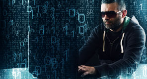 Hacker typing on laptop computer keyboard binary code background. Computer hacker cyber crime concept stock image