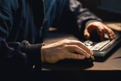 Hacker typing on pc keyboard. Photo of male hacker typing on pc keyboard Royalty Free Stock Image