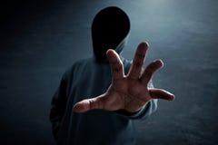 Hacker unlock data. Hacker alone in dark room Stock Image