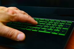 A hacker uses code to hack networks in cyberspace.  stock images