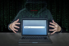 Hacker using adware fireball to control laptop computer Royalty Free Stock Image