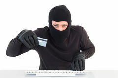 Hacker using card to steal identity Stock Photo