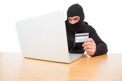 Hacker using card to steal identity Royalty Free Stock Photography