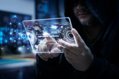 Hacker using clear tablet with HUD panel and code graph bar data Stock Photography