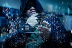 Hacker using clear tablet with HUD panel and code graph bar data Royalty Free Stock Photo