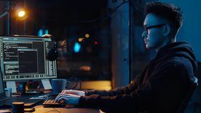 Hacker using computer for cyber attack at night
