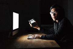 Hacker using computer and stealing information from hard disk Royalty Free Stock Images