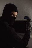 Hacker using debit card and laptop Stock Images