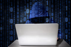 Hacker using keyboard typing bad data into computer online syste Stock Photography