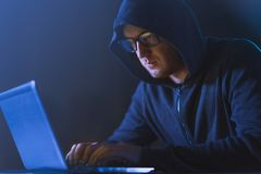 Hacker using laptop computer for cyber attack stock photography