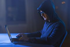 Hacker using laptop computer for cyber attack stock photos