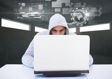 Hacker using a laptop in a dark room Royalty Free Stock Images