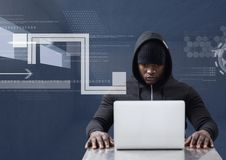 Hacker using a laptop in a dark room Royalty Free Stock Photos