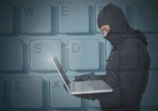 Hacker using a laptop in front of digital background of keyboard. Digital composite of Hacker using a laptop in front of digital background of keyboard Stock Image