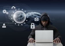 Hacker using a laptop in front of digital graphics Royalty Free Stock Photography