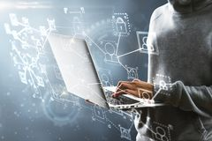 Hacking and criminal concept. Hacker using laptop with interface on blurry background. Hacking and criminal concept. Double exposure stock photography