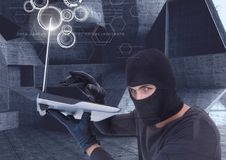 hacker using a laptop in a minimalist room royalty free stock images