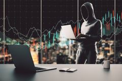 Trade and malware concept. Hacker using laptop in modern office interior with supplies, coffee cup on desktop and night city view with forex chart. Trade and stock image