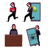 Hacker using laptop, stealing credit card information, money, identity Stock Image