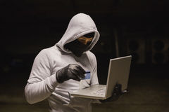 Hacker using laptop to steal identity Stock Photos