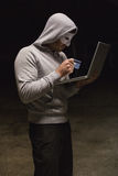 Hacker using laptop to steal identity Royalty Free Stock Image