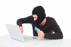 Hacker using laptop to steal identity Royalty Free Stock Photography
