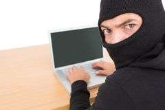 Hacker using laptop to steal identity Royalty Free Stock Photo