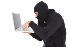 Hacker using laptop to steal identity Stock Images
